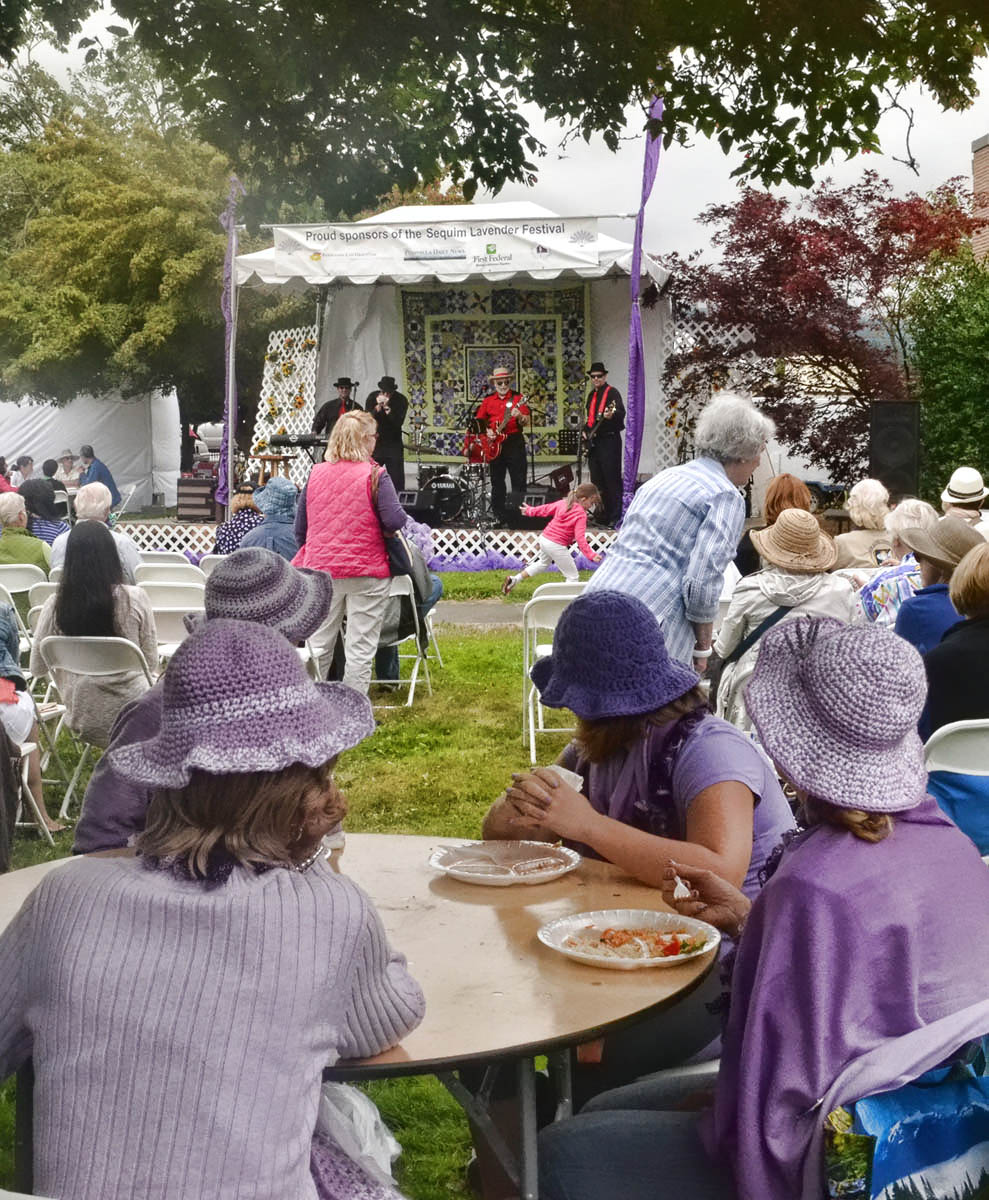 The Purple Hat ladies enjoy the live music