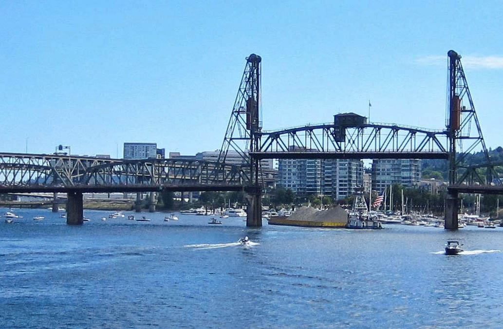 """Note center of """"draw bridge"""" raises up to allow gravel barge to barge through pleasure boats at Blues Fest"""