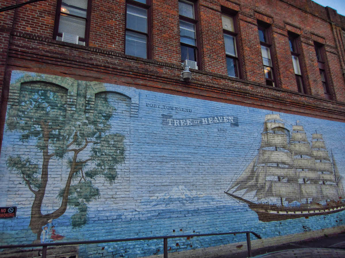 "Mural named ""Tree of Heaven.""  On the commemorative plaque, someone crossed out ""of"" and wrote ""Tree in Heaven."""