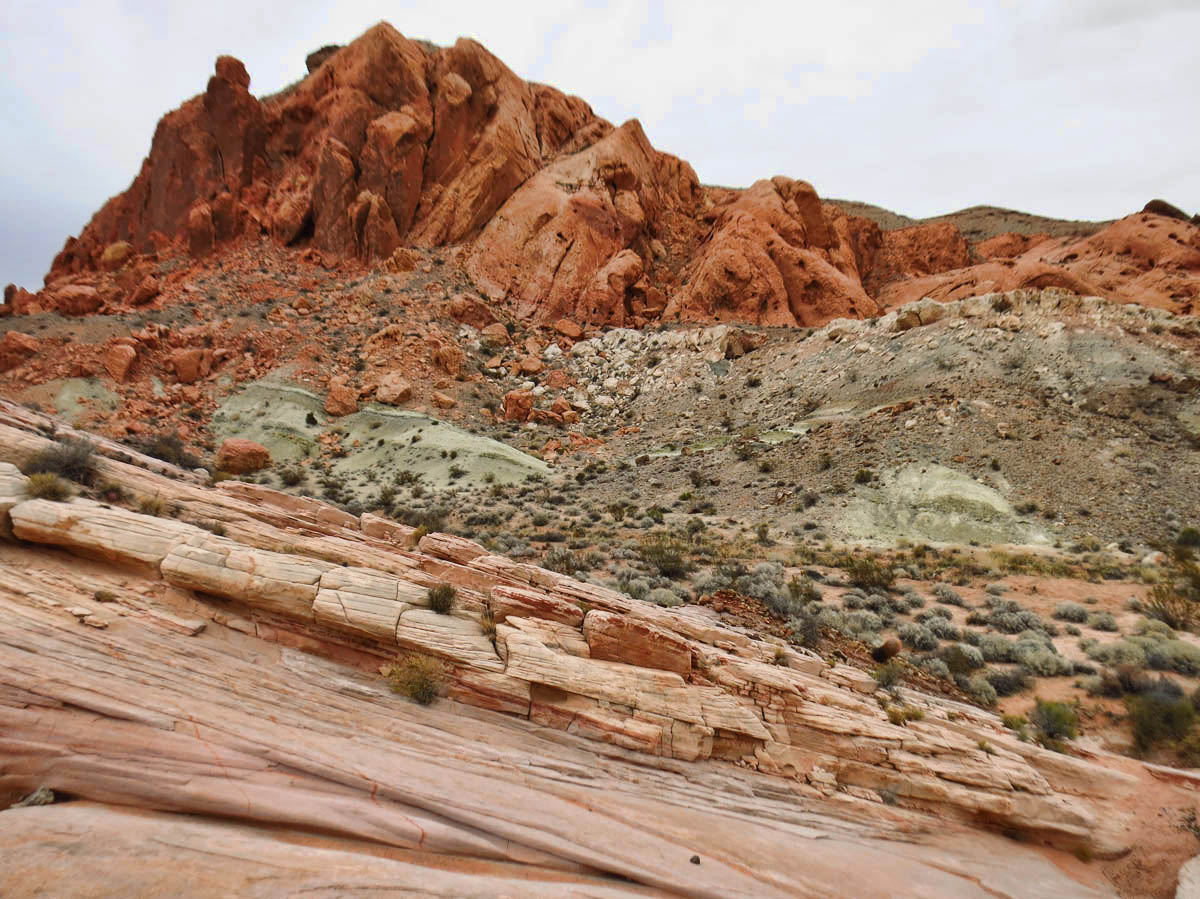 "I love the ""pistachio green"" color sandwiched in all the red rock."