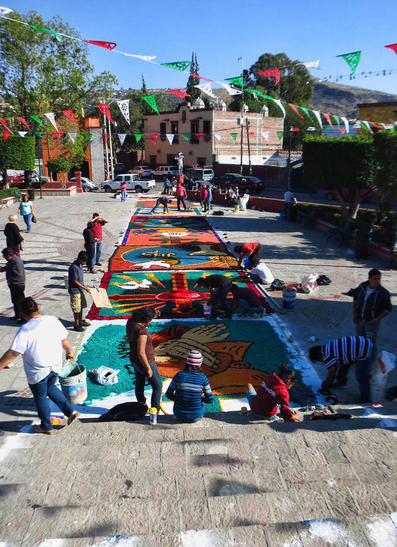 "A ""sawdust carpet"" being constructed leading into Parroquia de San Antonio."