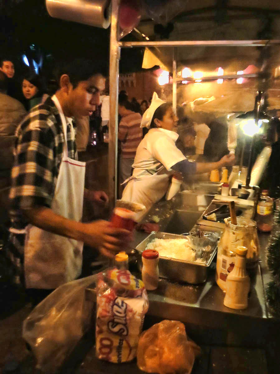 Street food vendors do a brisk business on New Years Eve.