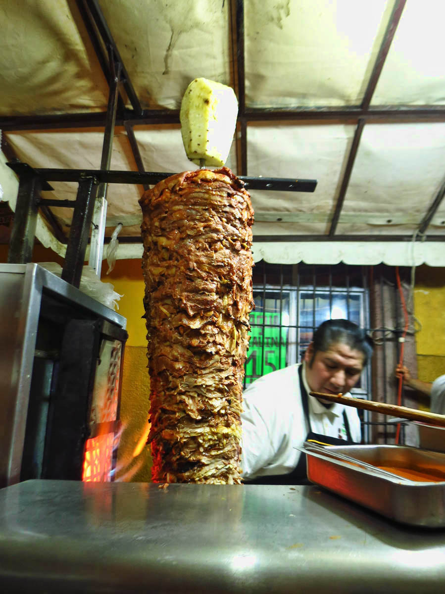 My favorite street taco stand on Insurgentes.  Tacos al Pastor with a slice of that fresh pineapple overhead.  SO yummy!