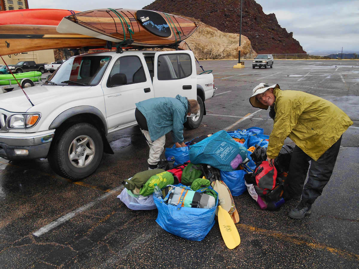 The rain still threatens, so John looks for a tarp to cover our gear.