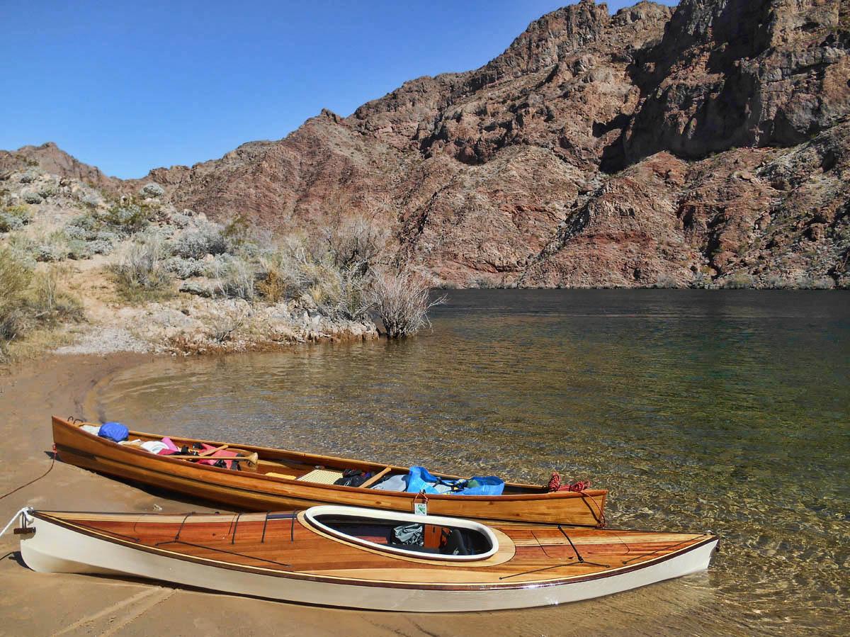 "John's handmade canoe, ""Knot Again,"" and Kathy's handmade kayak, ""Knot Too Shabby."""