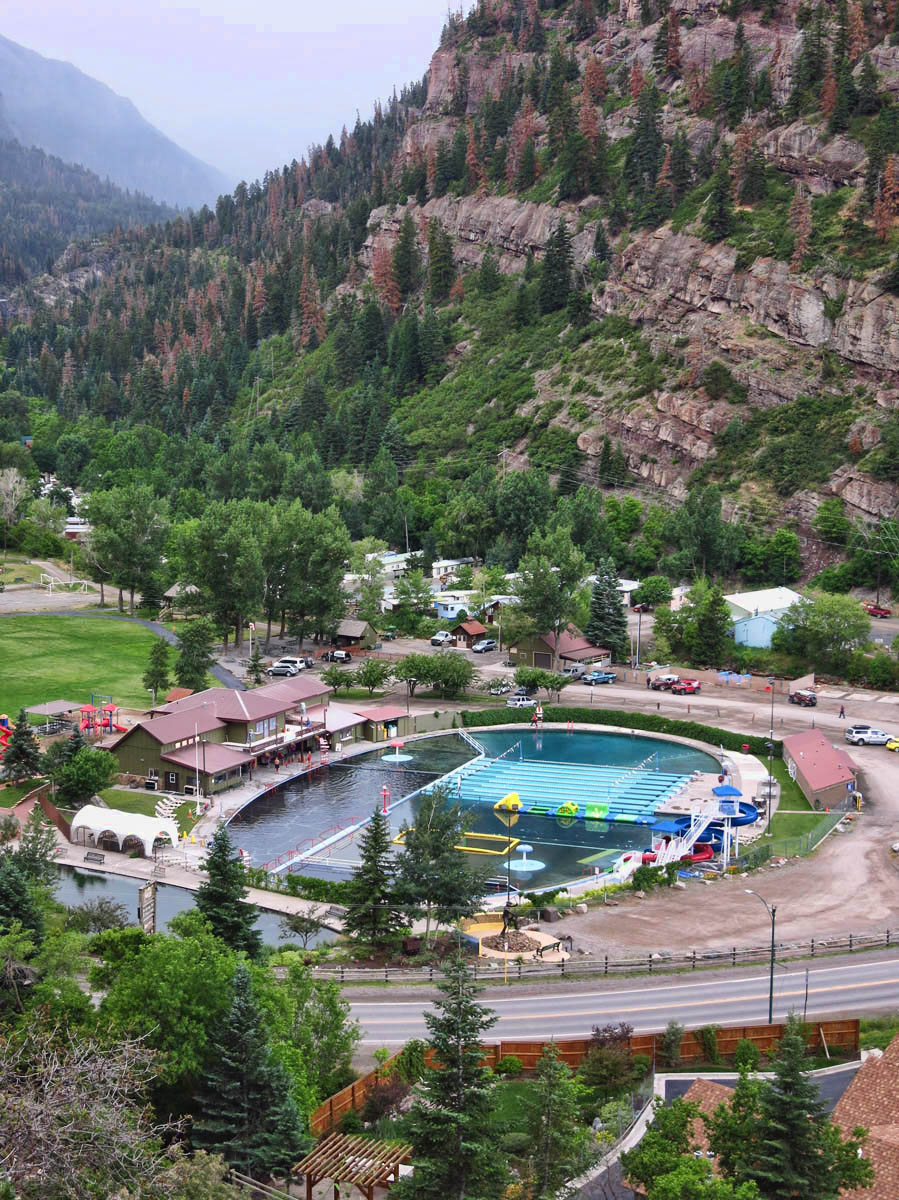 The calm before the summer storm at the Ouray Hot Springs Pool.