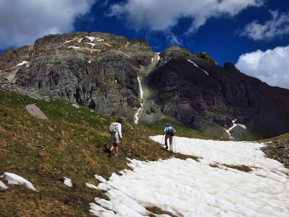 Tamara and Bobbie tracing around the snow pack.