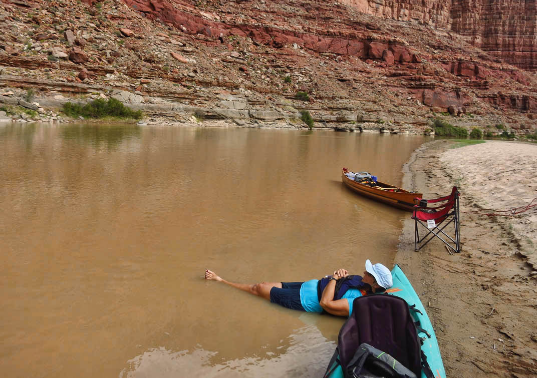 With shade so limited and the temps still unseasonably high, often times the only relief came from the river.  Here, BJ relaxes in the water along the shallow bank.