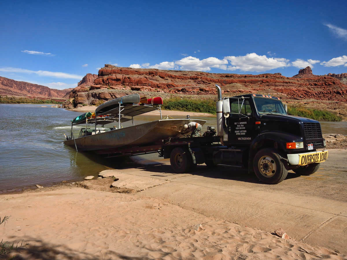 We reach the boat dock at Potash Road, but we do not have to unload the kayaks.  They will drive the jet boat onto the trailer, and drive it back to Moab, while we ride in the school bus.