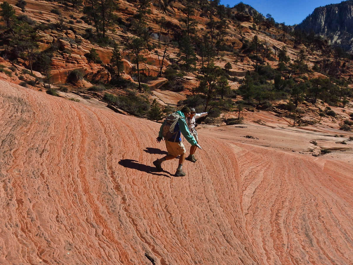 """Chris and Bobbie """"surfing"""" the waves of the Red Sea of sandstone."""