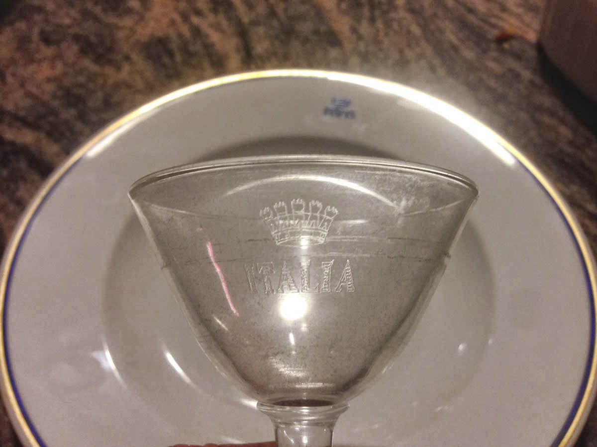 "Crystal still shows etched ""Italia"" insignia."