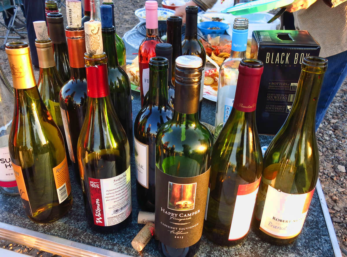 "Wine Night at the View/Navion rally.  Note the label on the center bottle, ""Happy Camper!"""