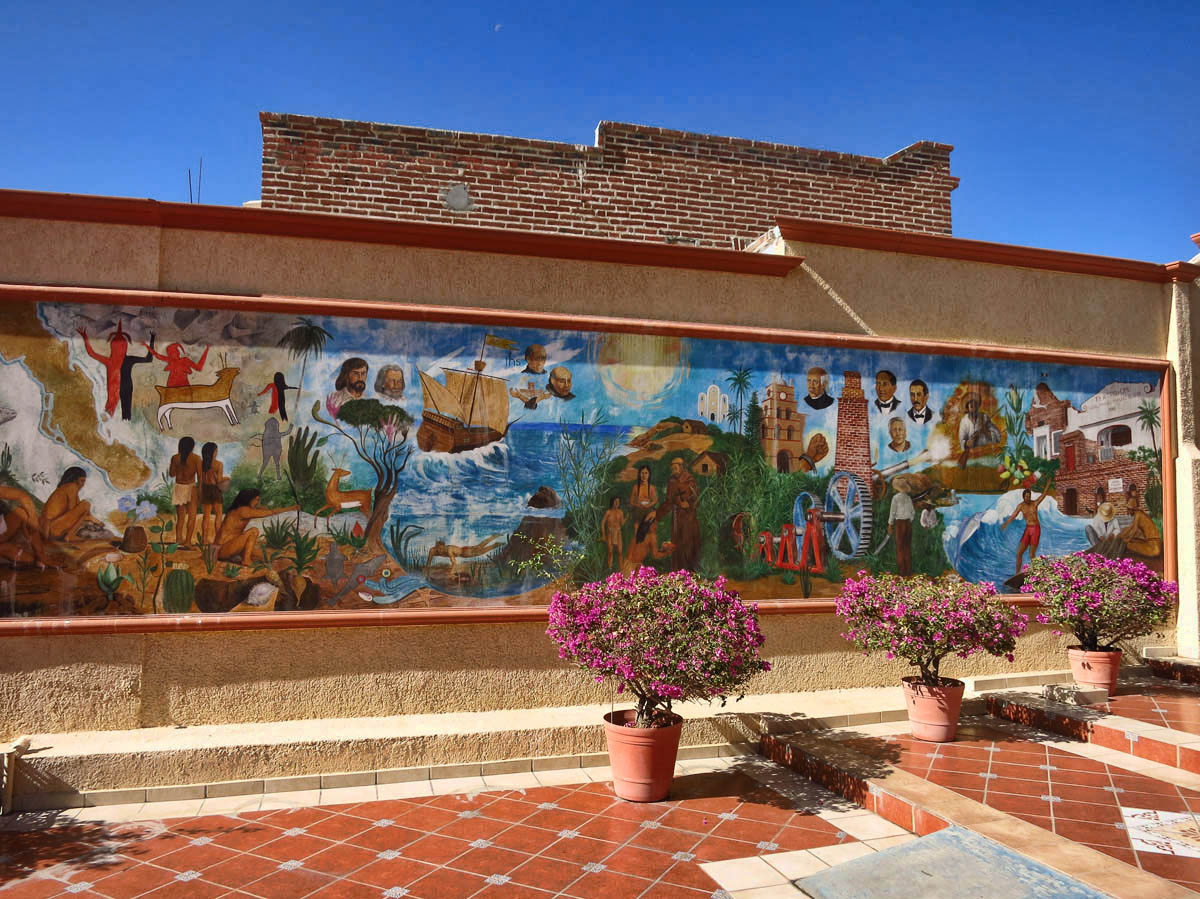 This mural depicts inhabitants of Todos Santos starting with indigenous people on the left, all the way to surfers on the right.
