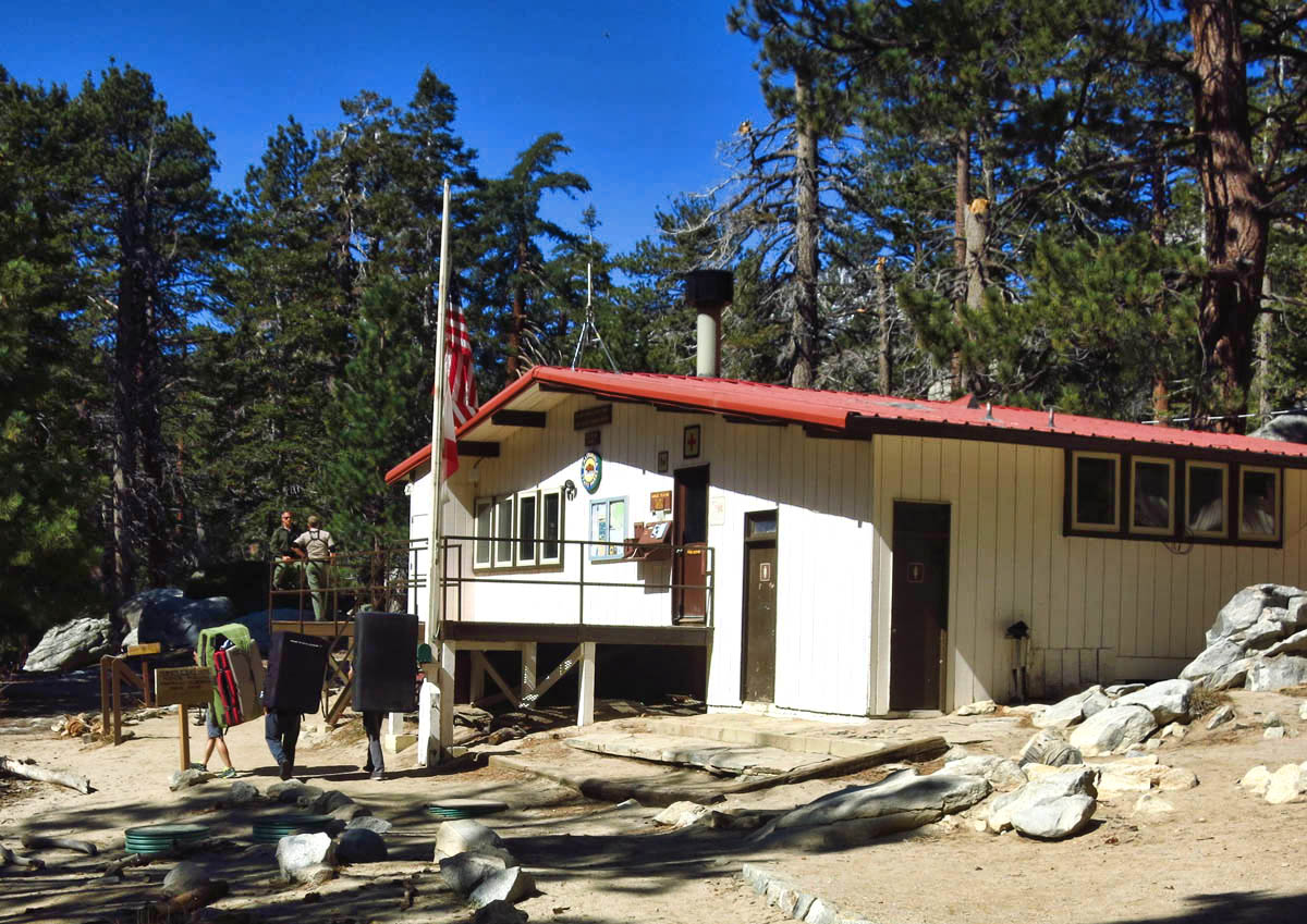 "Ranger Station in Long Valley near tram. Large packs on climbers backs are ""crash pads."""