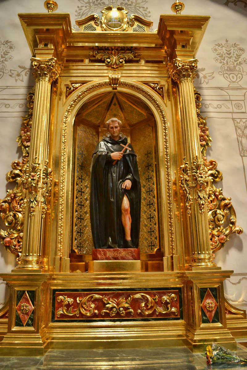 Saint Peregrine, showing a little leg...