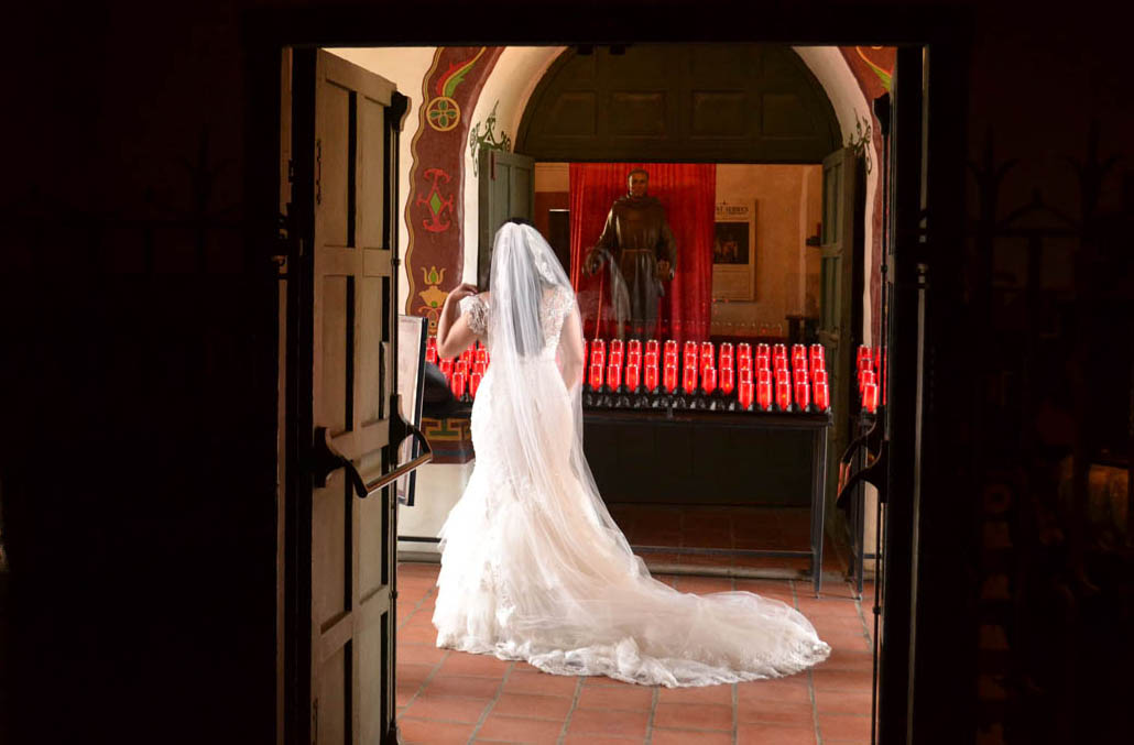 A pensive bride waits on her photographer.