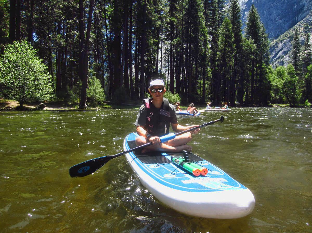 Jona opts to raft the river on a stand-up paddleboard. (Notice he is packing heat.)