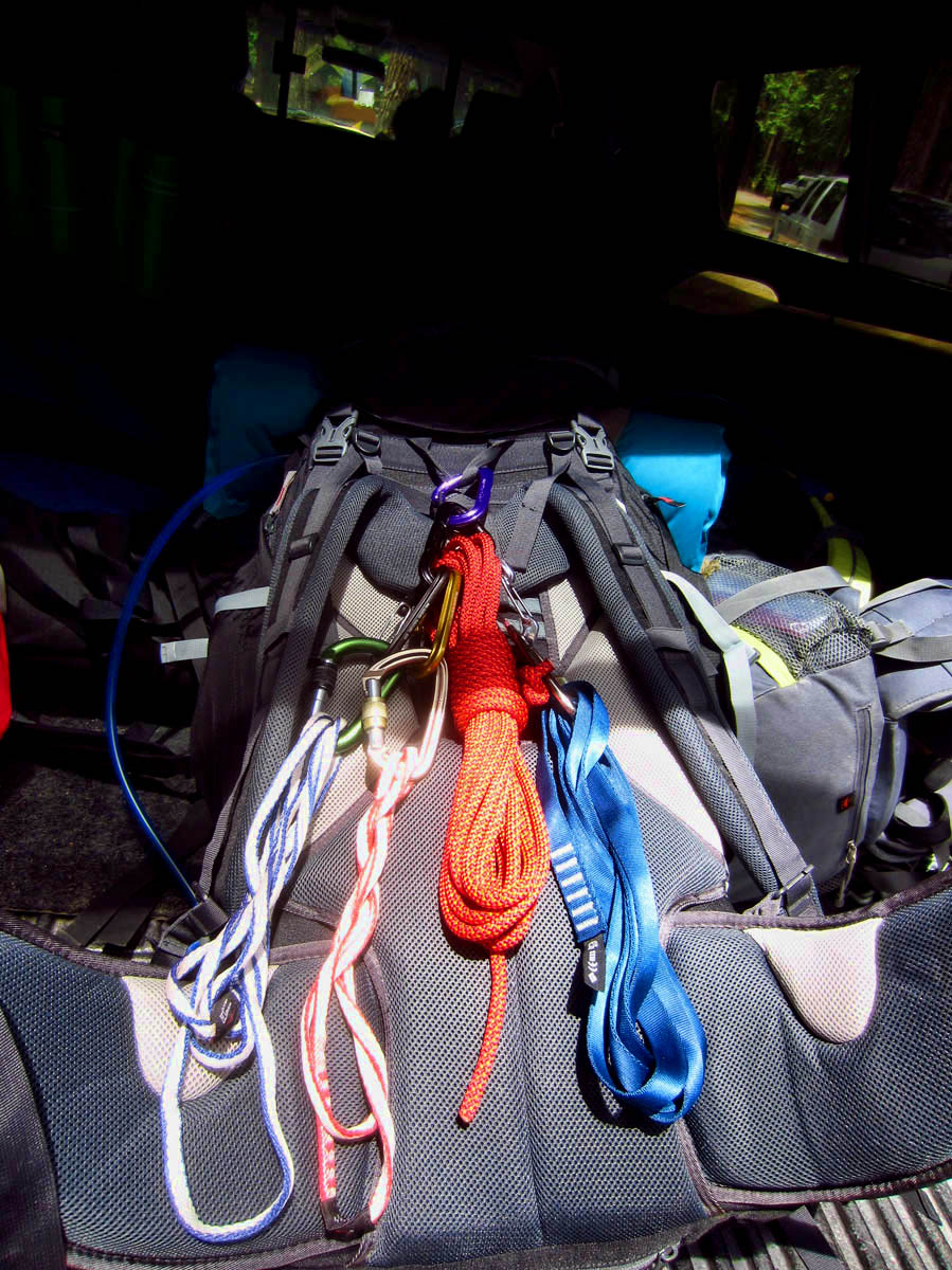 Jona, our Eagle Scout climber has fashioned us each a modified Swiss sling harmess including two caribiners for safety.