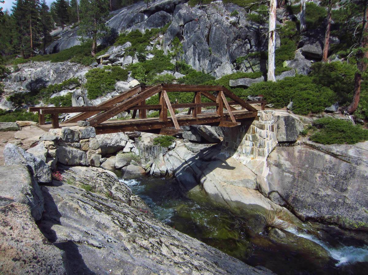 Bridge crosses Yosemite Creek, which plunges over into Yosemite Falls