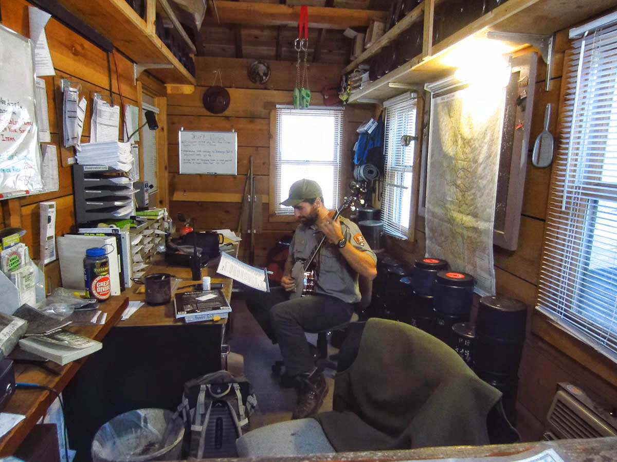 "Look what else I found at ""Roads End!"" This very cool Ranger in the Wilderness Permit hut playing his banjo."