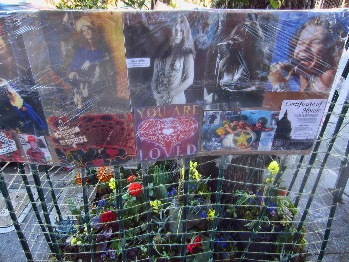 Rudimentary shrine to Janis Joplin built around a light pole.
