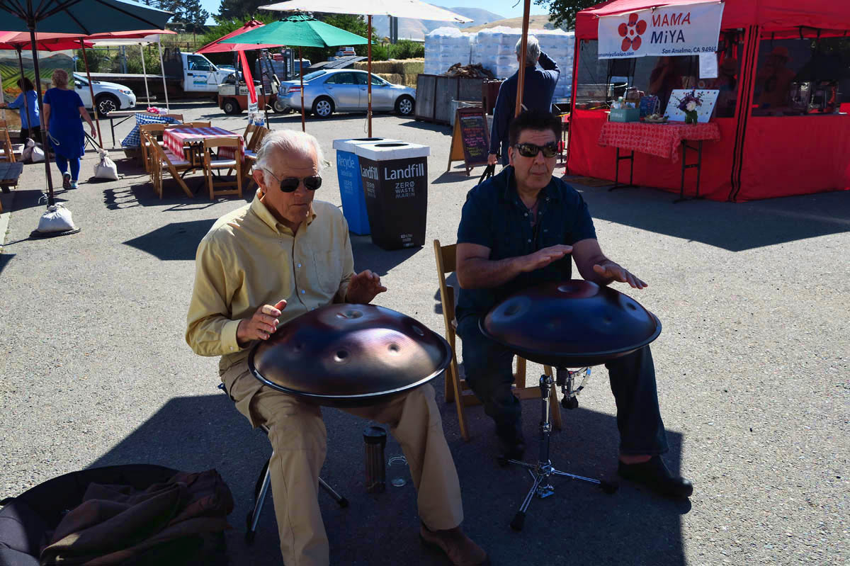 I am not sure what instrument these guys are playing, but it looks like an inverted wok. It's lovely music.
