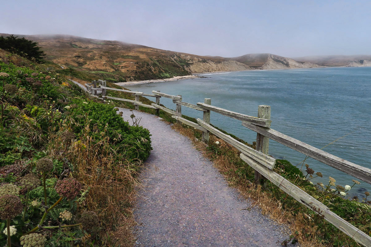 "Point Reyes Lighthouse sits at the tip of a ""spit"" that looks like an upside down ""T."" At the opposite end is Chimney Rock hike and Elephant Seal viewing area."