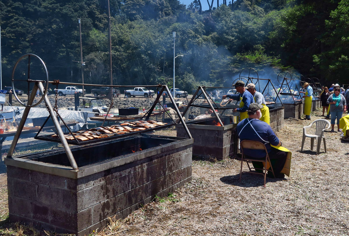 "Salmon is being grilled all along the waterfront at the ""World's Largest Salmon BBQ."""
