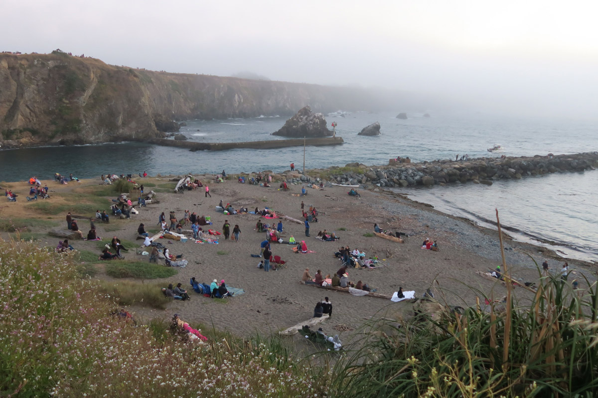 """Crowd"" assembles on the beach for fireworks, one of the recommended viewing locations."