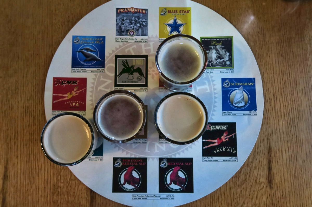 "A flight from North Coast Brewery makes for a good stop after beachcombing. I like their ""place-mat"" where corresponding tastes are placed over the brew's logo and description. That way, I can see what i missed. ;-)"