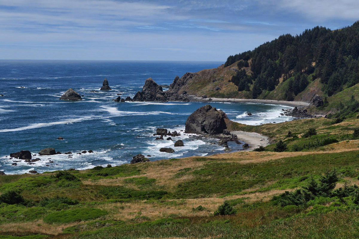 Oregon Coast Trail runs 27 miles along the coast in this section.