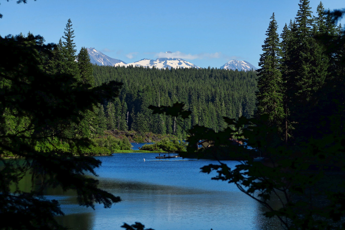 """The three """"Sisters"""" mountains can be seen from the lake's edge."""