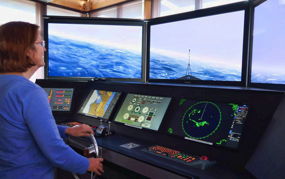 "Inside the Northwest Maritime Center, there is an amazing ""Pilot Simulator,"" where you can steer the ship through the storm and never get your feet wet!"