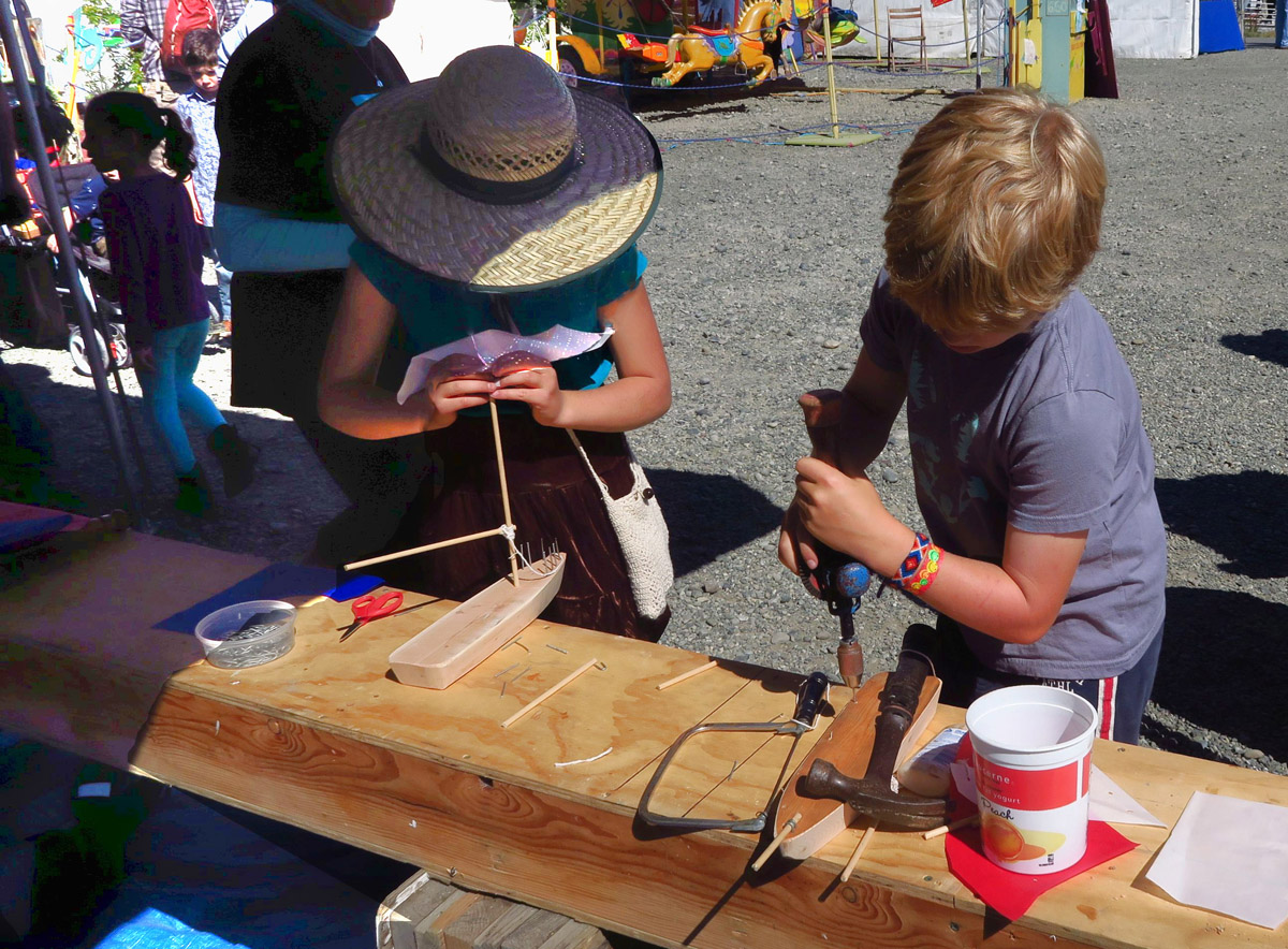 Lots of activities for kids. Here, they are taught how to build their own wooden boat.