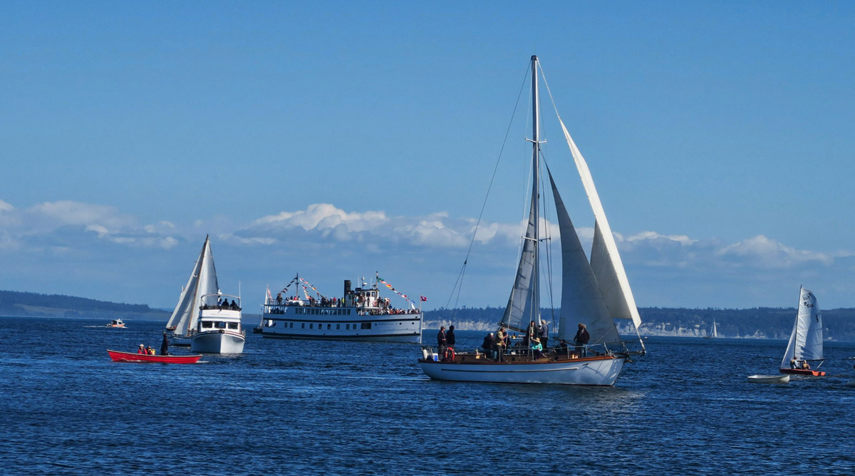 Vessels of all shapes and sizes enter Port Townsend Bay for the Sail-By.