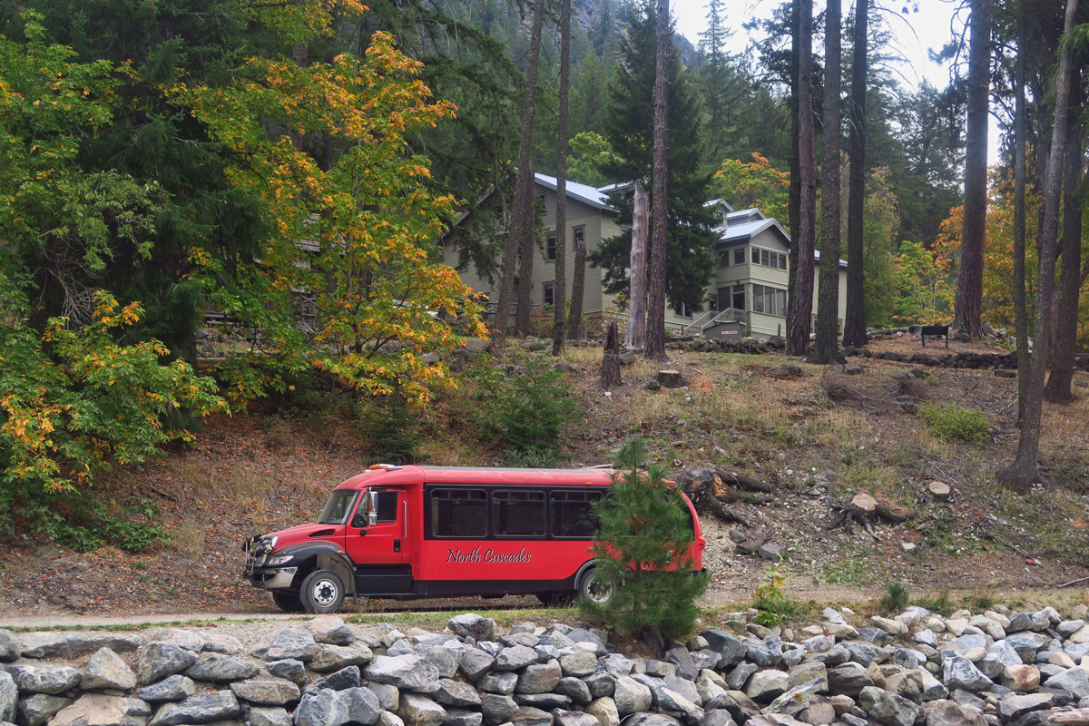 "Stehekin ""Red Bus"" Shuttle in front of the historic Golden West Visitor Center."