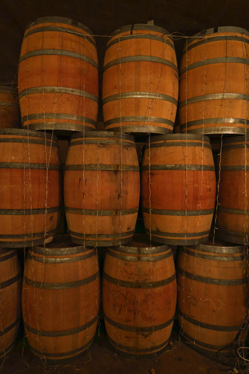 Aging barrels in Karma's underground wine cave.