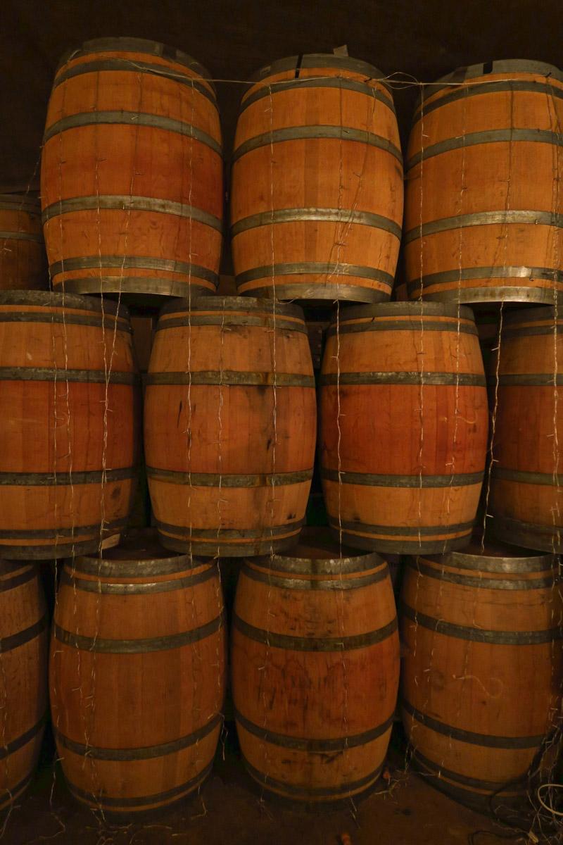 Aging barrels in Karma's underground wine cave.