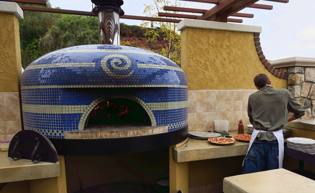 Wood-fired pizza oven.