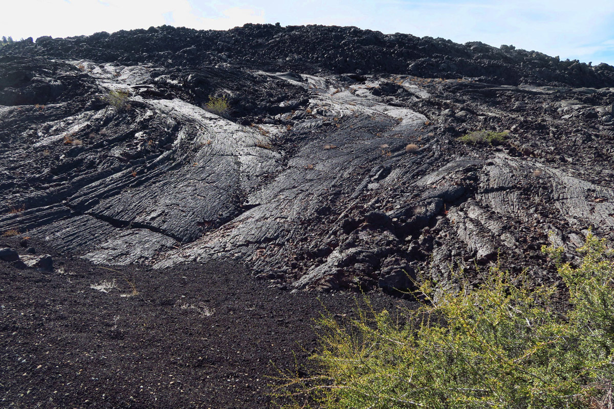 "The ""cascades,"" formed when pāhoehoe lava flowed around `a`a lava."