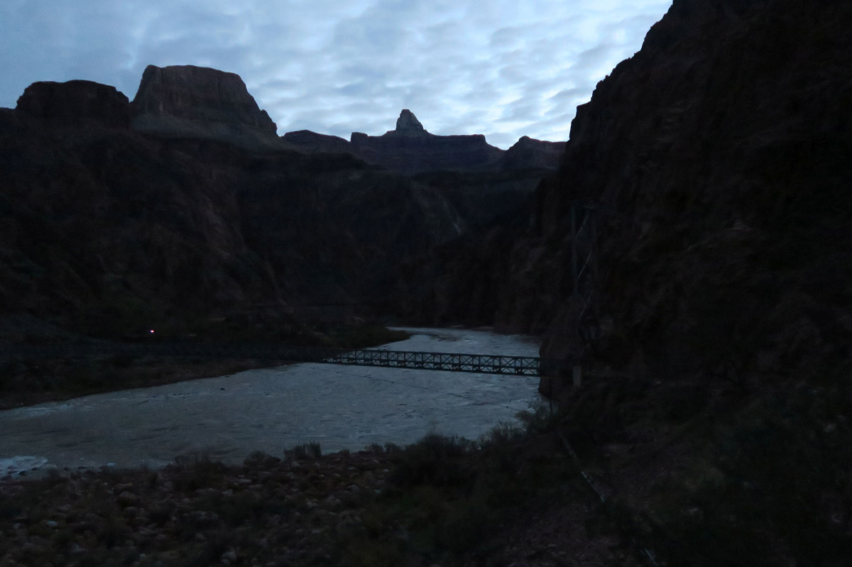 "The tiny dot of a light at the left of the bridge is another hiker with a ""miners"" headlamp."