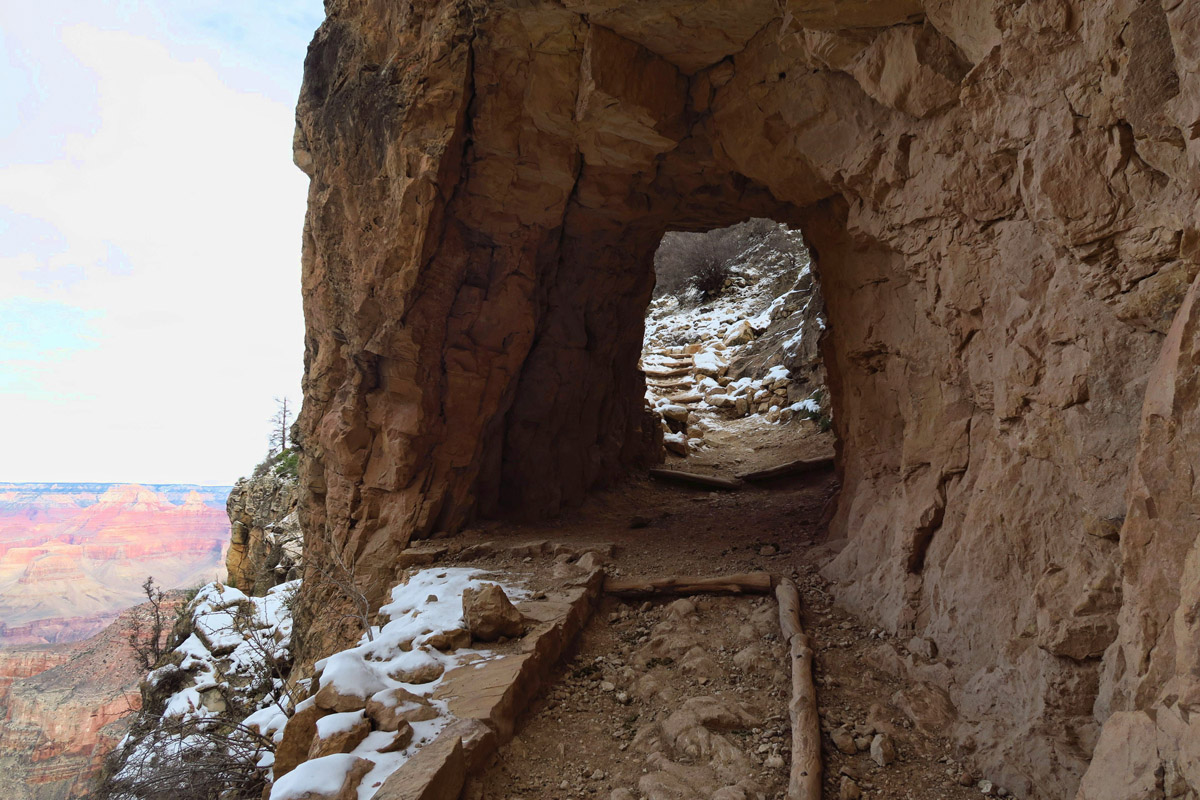 """One of several """"tunnels,"""" or holes carved in the rock to accommodate the trail."""