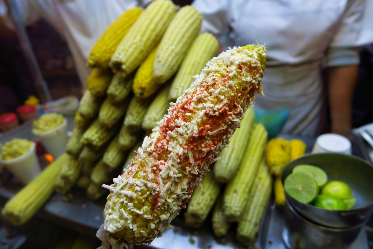 One of my favorite New Years traditions in Mexico...corn on the cob slathered in Mayo, rolled in chihuahua cheese, and sprinkled with chili.