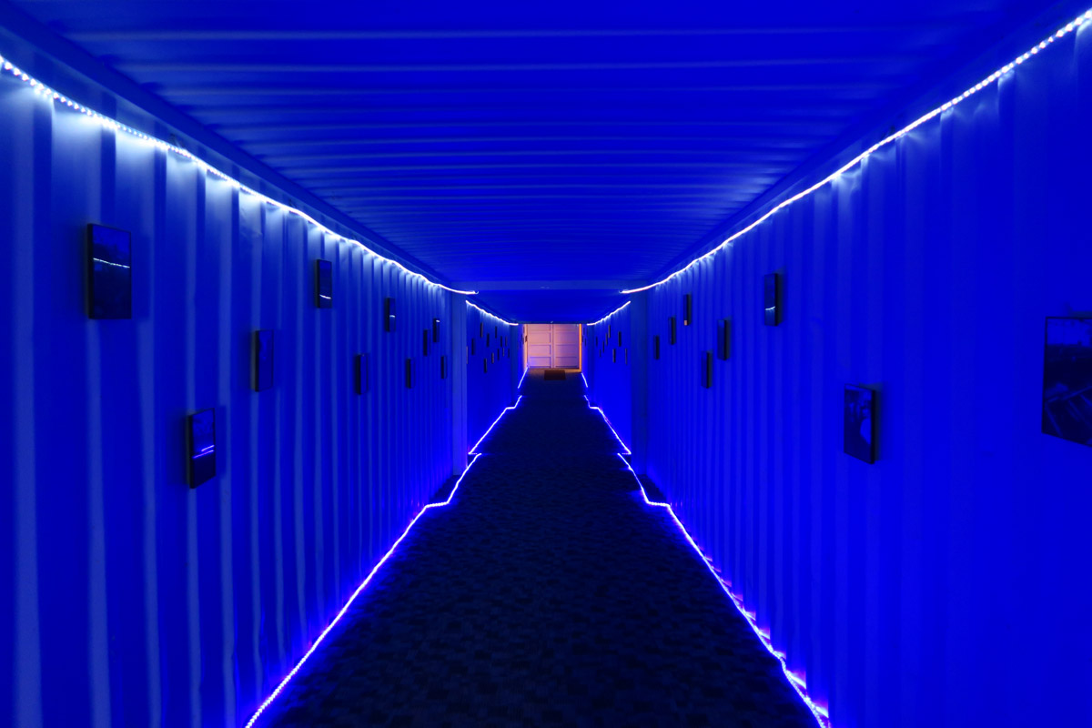 The long, cold, neon blue hallway from the main building to the Greenhouse.