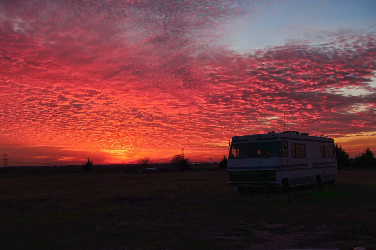 "Sunset on the farm, where Winnie rests for the winter with her cousin, ""Old Bessie,"" his original RV prior to the Navion. Now for sale. ;-)"