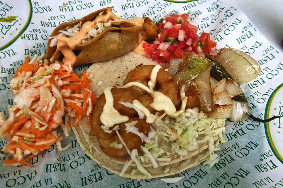 A Taco Pescado, as well as a Dorada empanada, or taco fried golden brown.