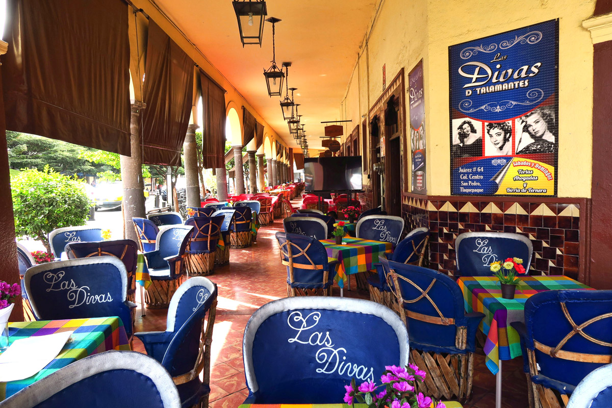 Inside El Parián, where restaurants are arranged in a circle around a gazebo in a courtyard with strolling musicians.