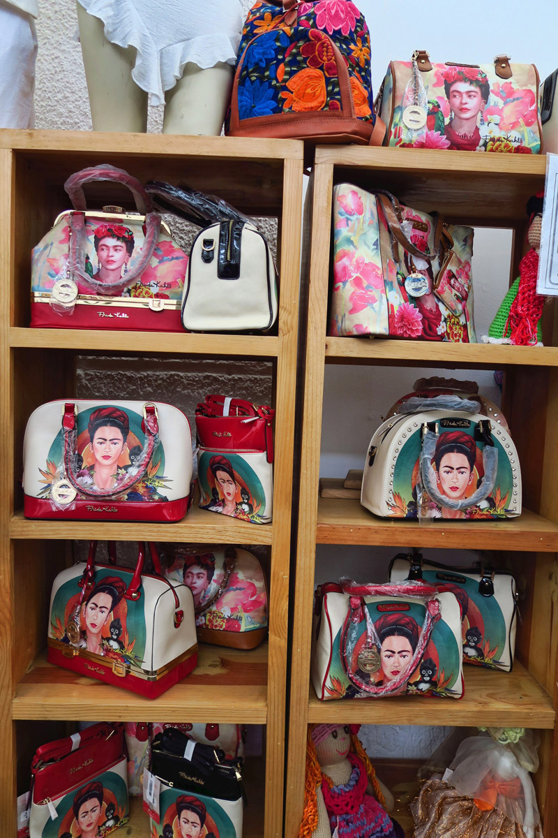 "An entire wall of ""Frida Bags."""