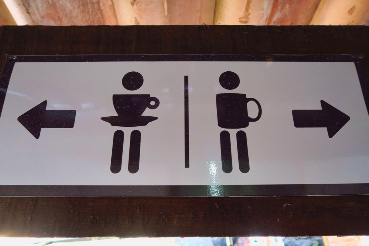 Loved this play on coffee cups for the toilet sign.