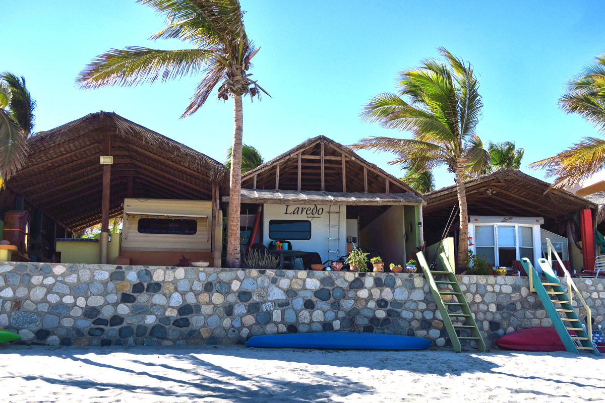 """These are known as """"Casitas la Playa,"""" or beach houses...thatched roofs over RV parking pads along the beach in Los Barriles."""